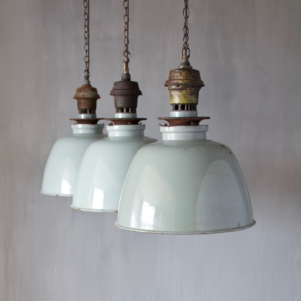 A Set Of Three Enamelled Pendant Lights - Set of three pendant lights